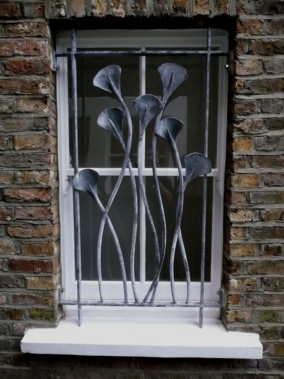Song sắt của sổ tạo hình hoa lá